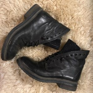 Black moto style boots with rhinestone tongue.
